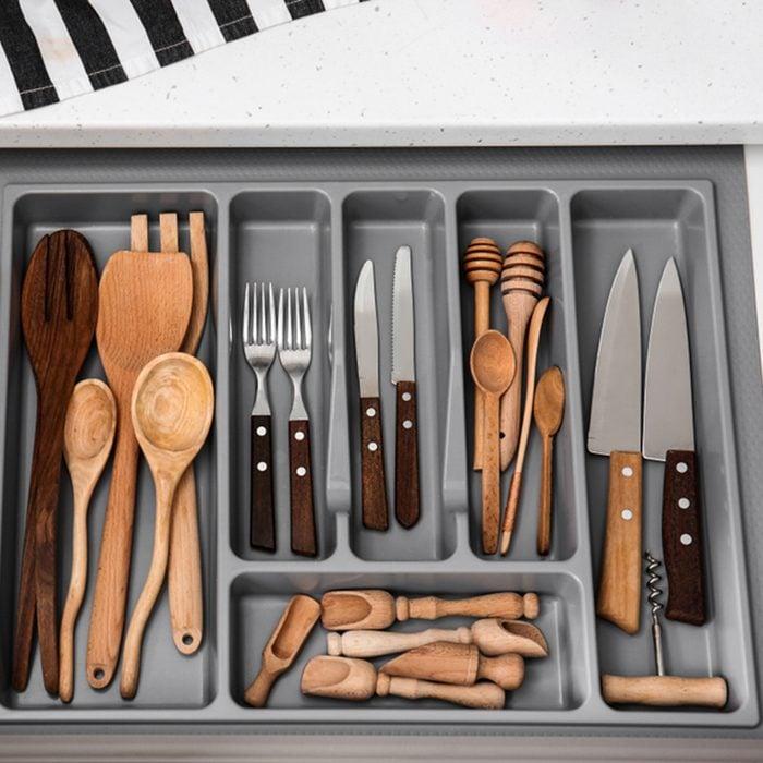 Set of clean kitchen utensils in drawer