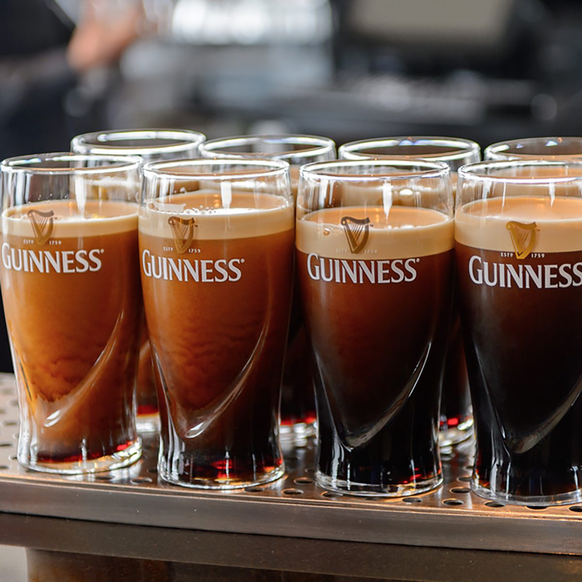 Pints of Guinness in the museum in Dublin. Guinness is an Irish dry stout produced by Diageo originated in the brewery of Arthur Guinness