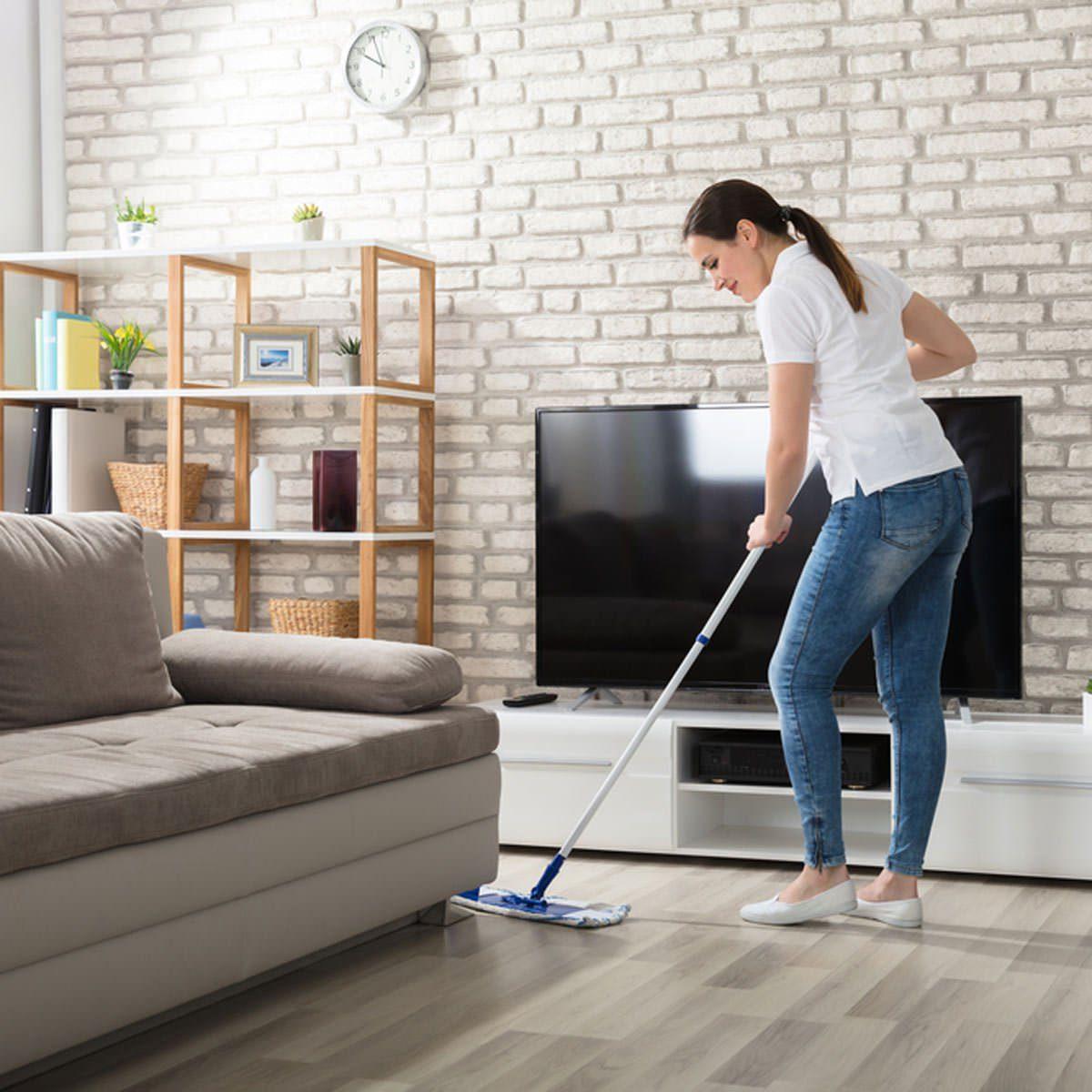 Woman cleaning hard wood floors