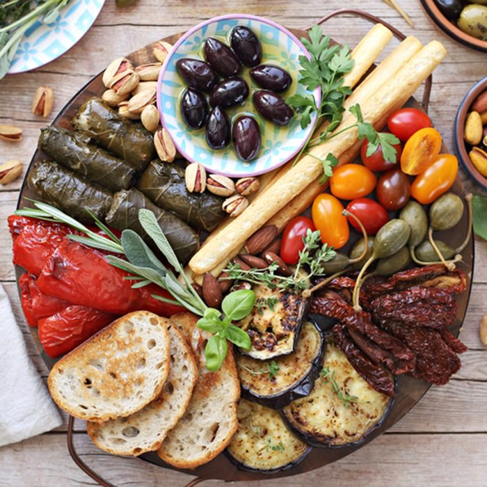 Mediterranean appetizers table concept. Platter with antipasto selection, grilled vegetables, olives, nuts and roasted bread. Overhead view.; Shutterstock ID 1124263523; Job (TFH, TOH, RD, BNB, CWM, CM): TOH