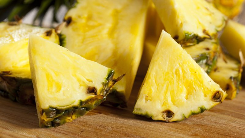 Fresh Yellow Organic Pineapple cut into slices; Shutterstock ID 120737074; Job (TFH, TOH, RD, BNB, CWM, CM): TOH How to eat pineapple