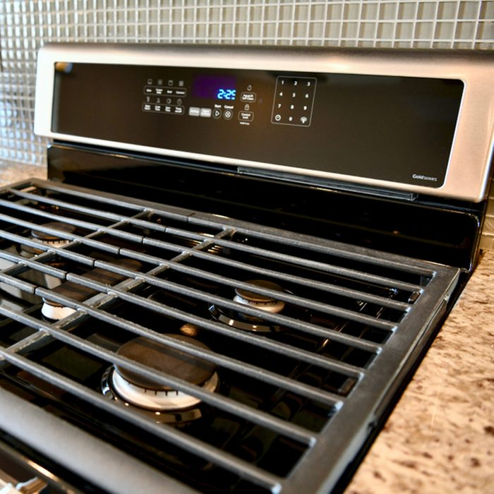 Kitchen appliance stovetop inside home.
