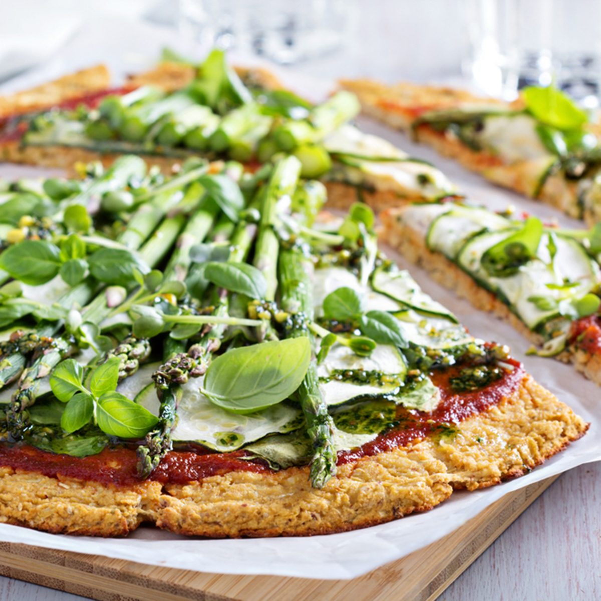 Cauliflower green pizza with spinach, zucchini and asparagus