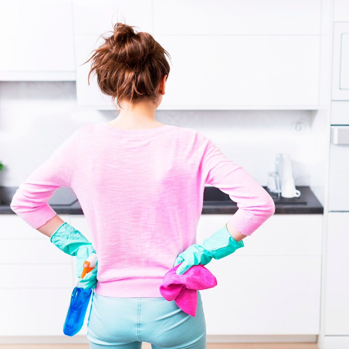 Woman with hands on her hips ready to tackle the kitchen