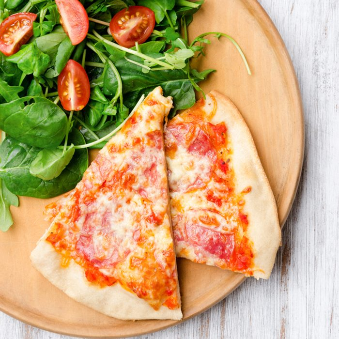 Pizza with salad for a balanced meal, overhead perspective