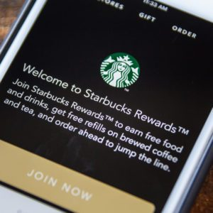 LAS VEGAS, NV - September 22. 2016 - Starbucks App On Apple iPhone Screen. Splash Screen Display. Selective Focus.; Shutterstock ID 487851379