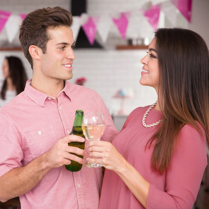 Couple toasting cheers at engagement party celebration engaged happy lovers with friends