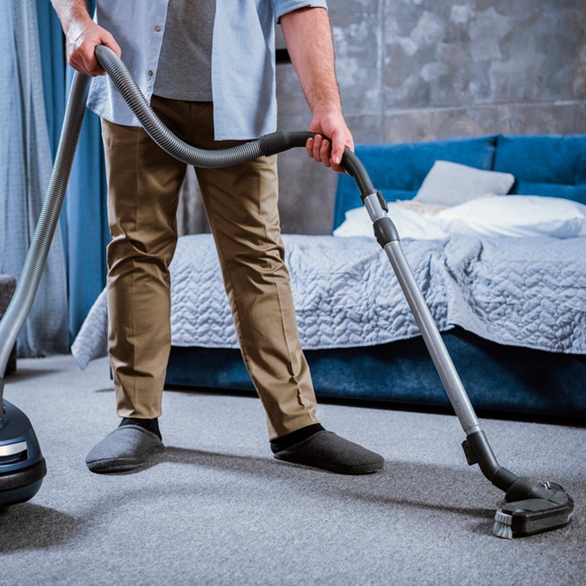 Vacuuming bedroom