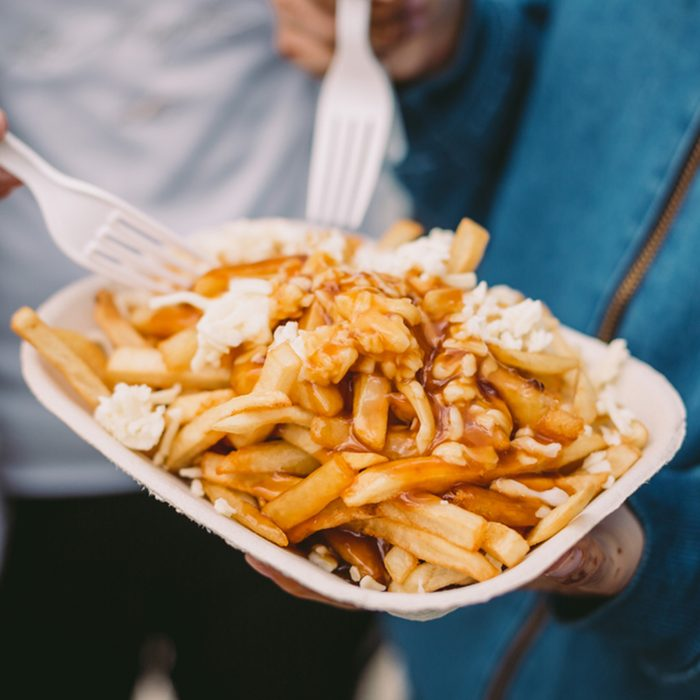 Poutine being eaten with forks; Shutterstock ID 797302909; Job (TFH, TOH, RD, BNB, CWM, CM): TOH