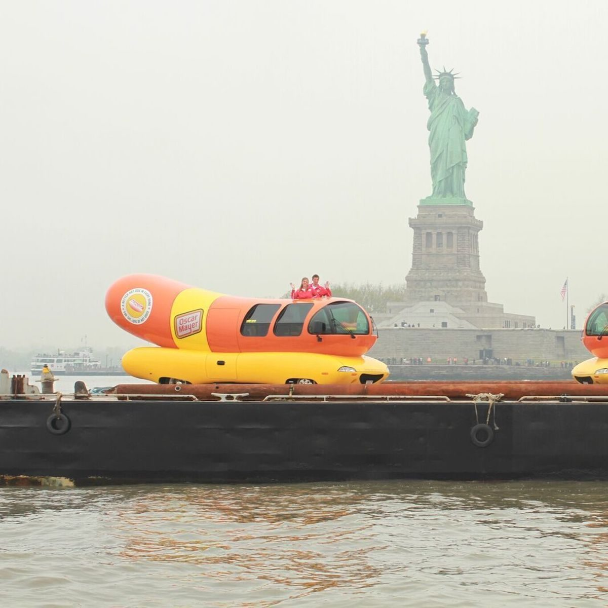 wienermobile and the statue of liberty
