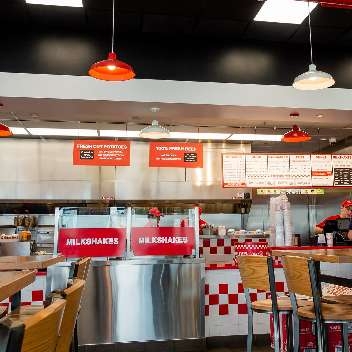 The interior of a Five Guys burger restaurant.