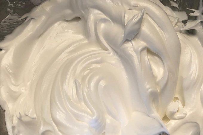 Making a Baked Alaska, beating the meringue