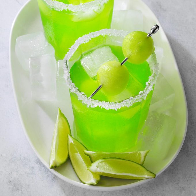 A homemade melon margarita served on the rocks.