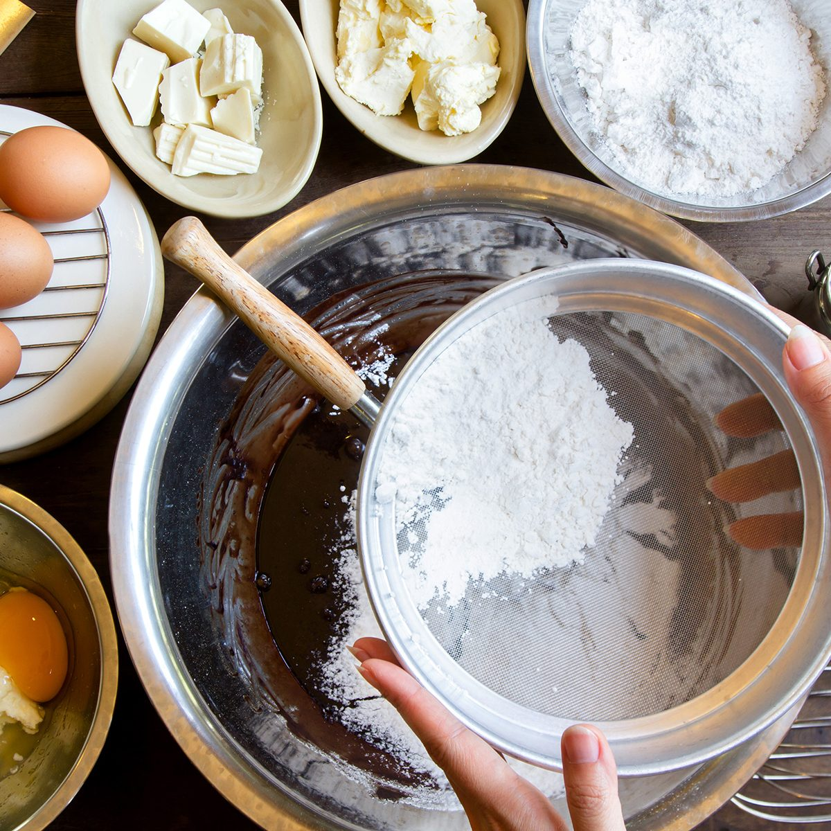 Hand Sift flour, Bakery prepare for make Chocolate brownie cake