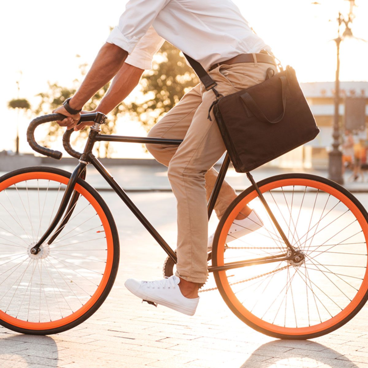 Cropped picture of handsome young african man early morning with bicycle