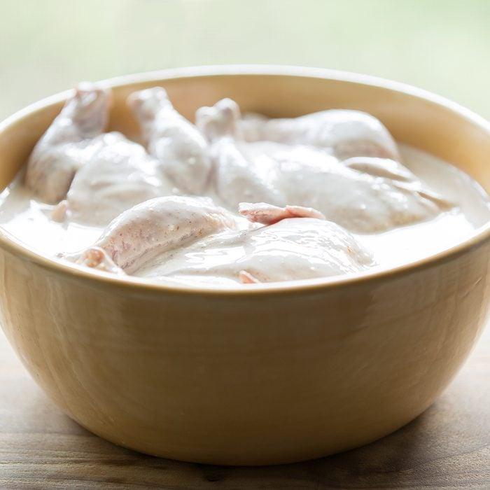 Cornish hens soaking in a buttermilk brine.