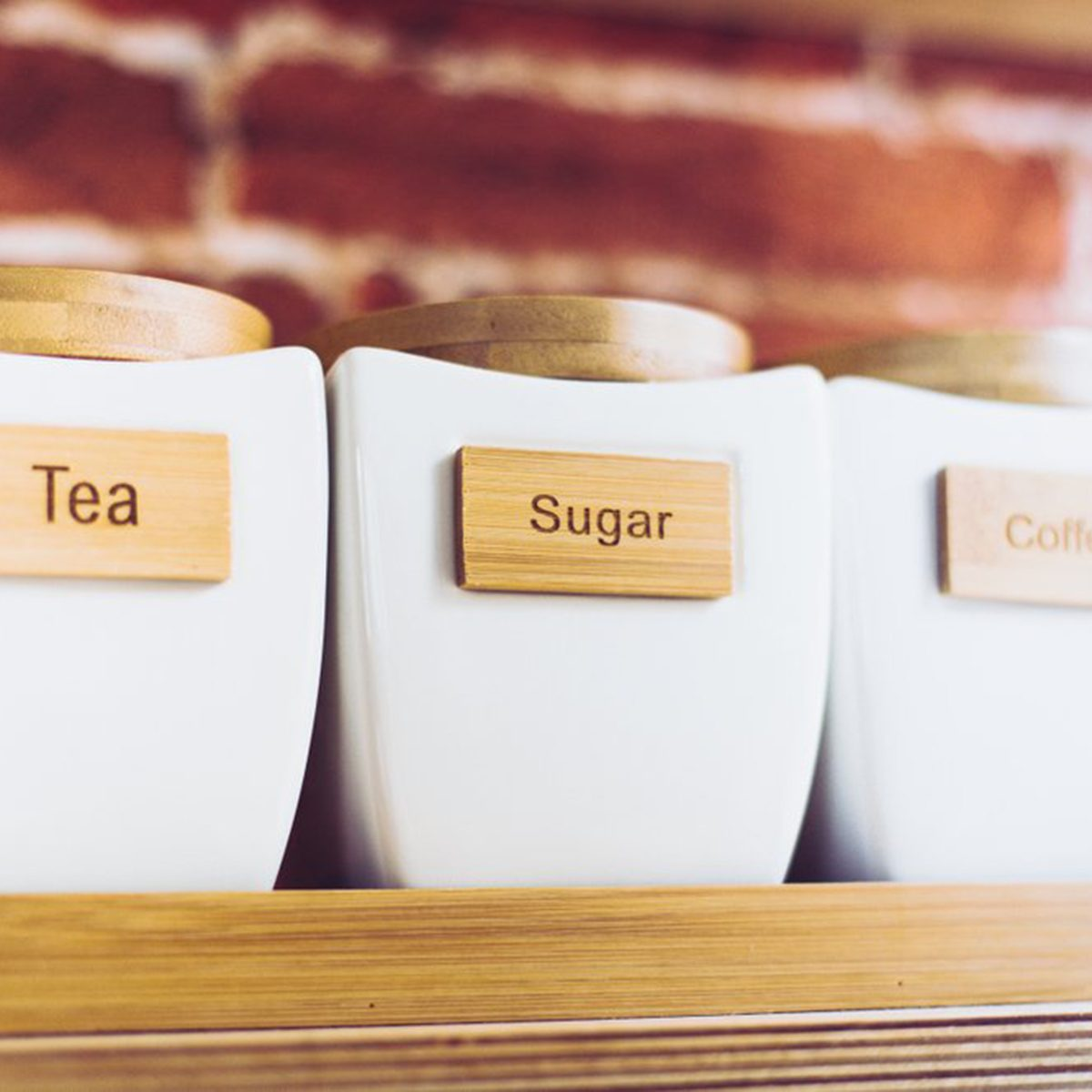 Canisters of tea, sugar and coffee