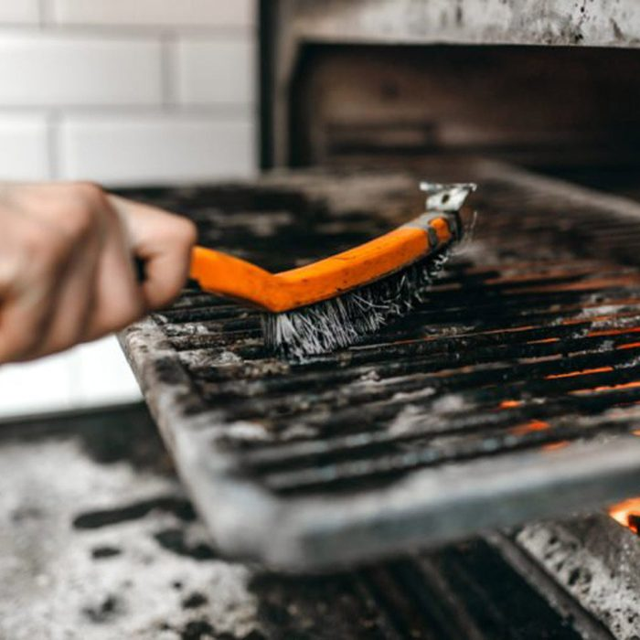 Cleaning the grill with a brush