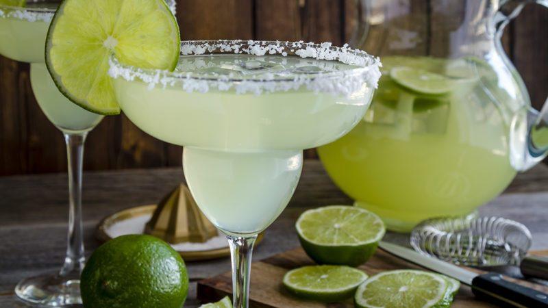 margarita pitcher, fresh limes and barware