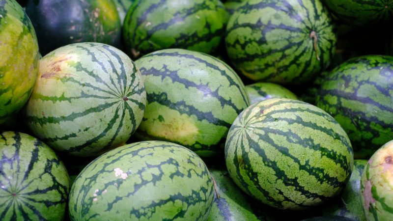 watermelons are stacked in a pile and ready to go to sale at the market