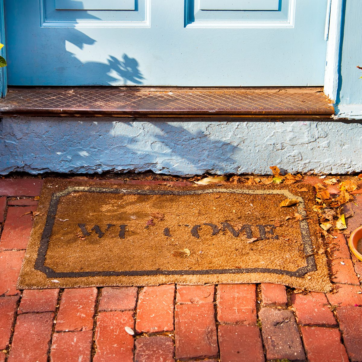Welcome mat outside a cottage front door. ; Shutterstock ID 192399047; Job (TFH, TOH, RD, BNB, CWM, CM): TOH
