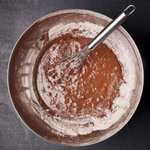 bowl of brownie batter and whisk