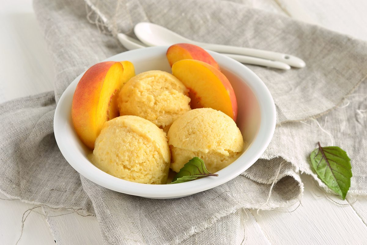 Homemade peach ice cream, sorbet; Shutterstock ID 495548767; Job (TFH, TOH, RD, BNB, CWM, CM): TOH froyo