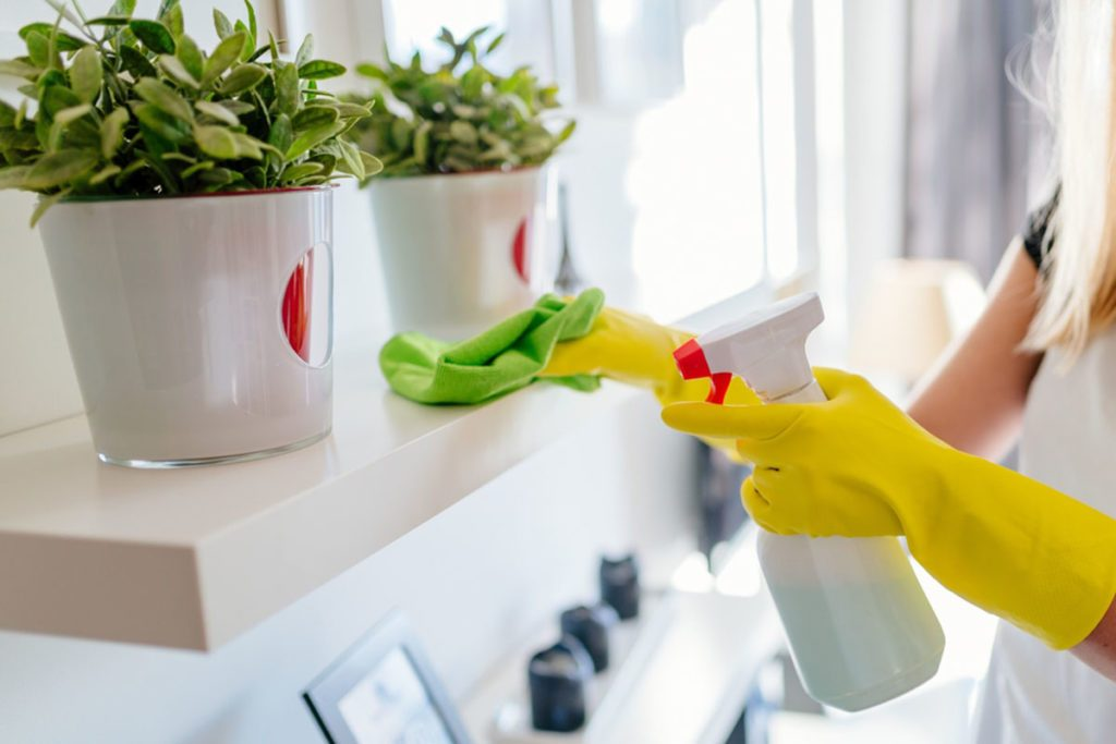 Woman wearing yellow rubber protective gloves and cleaning white shelf.; Shutterstock ID 546648745; Job (TFH, TOH, RD, BNB, CWM, CM): Taste of Home