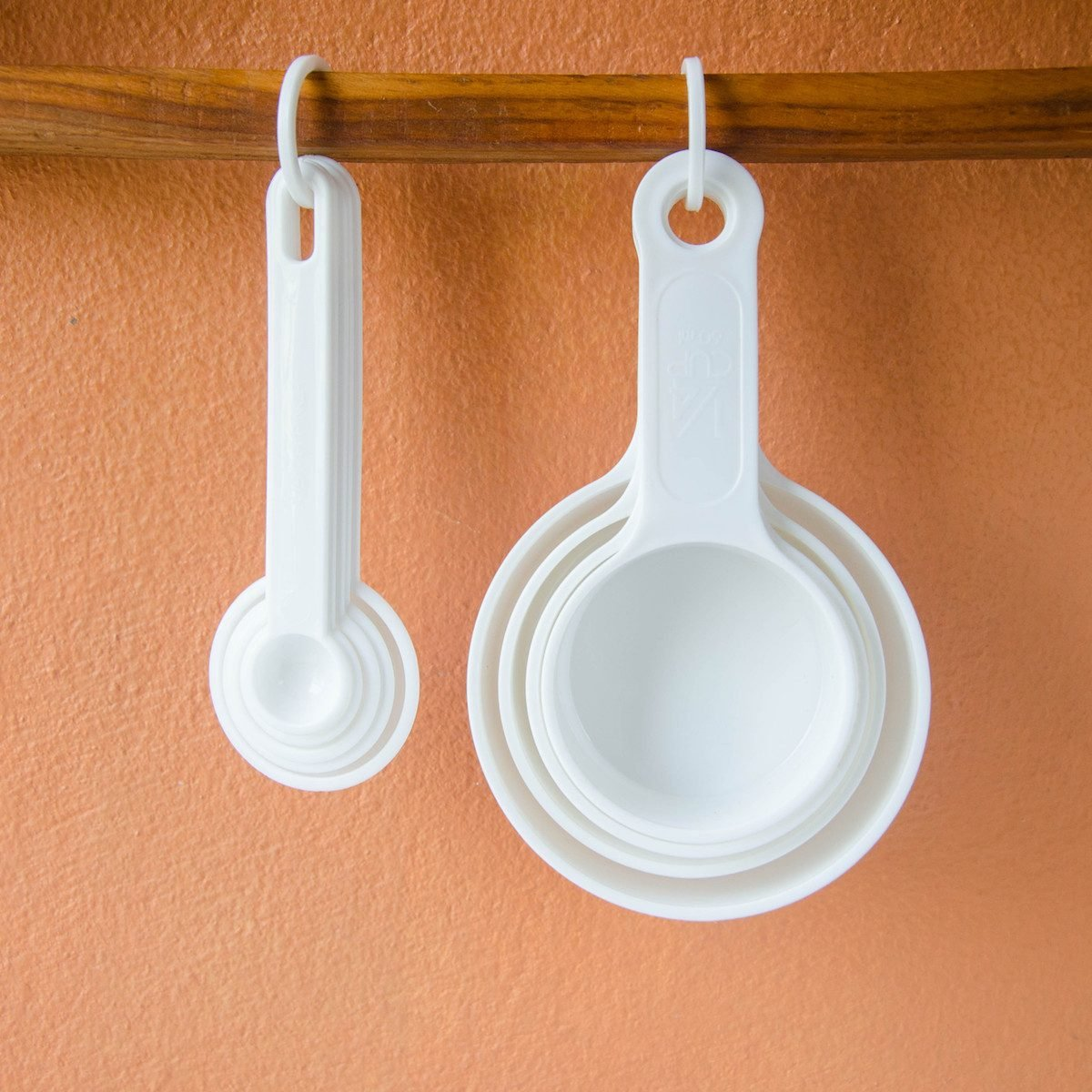hanging up measuring spoons and cups
