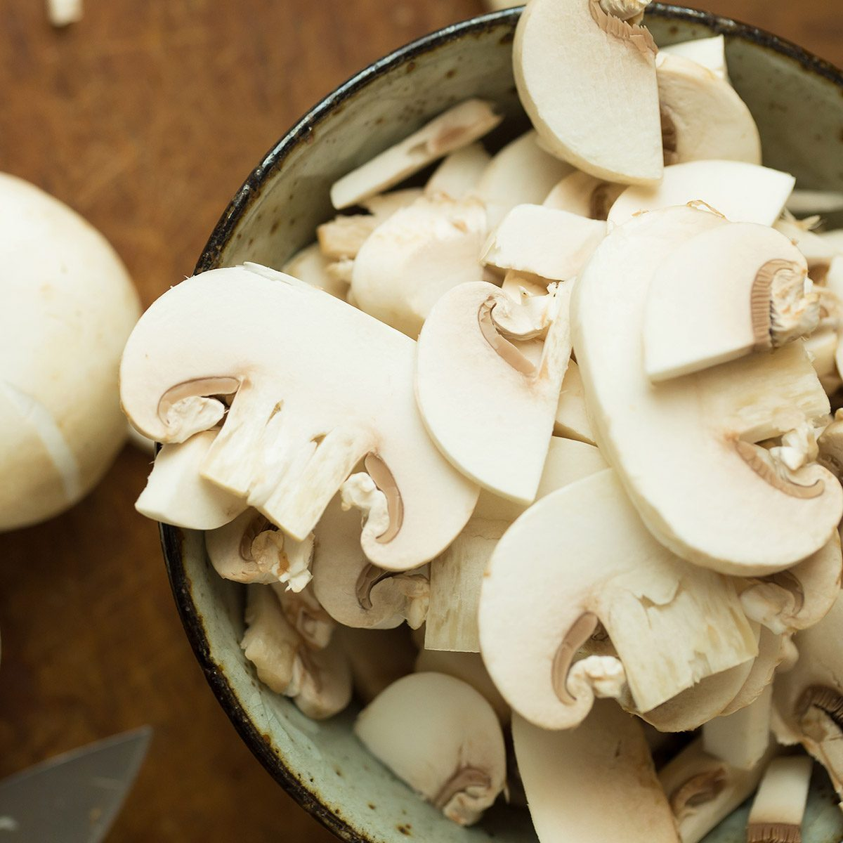 Champignon mushrooms on the wooden table. Selective focus.; Shutterstock ID 618976709