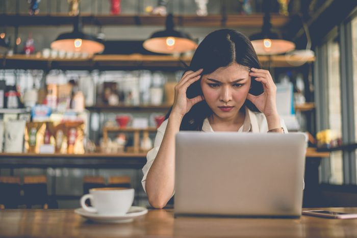 Asian freelance woman have stressed pressure when last day of final deadline to send task to her boss.