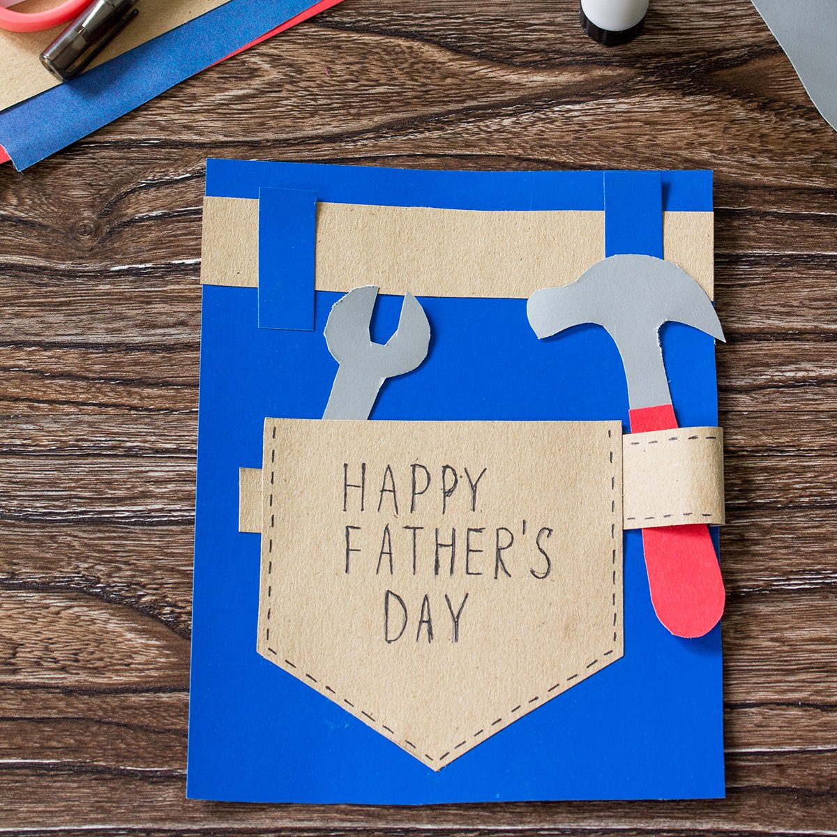 Greeting card with Happy fathers day on wooden table