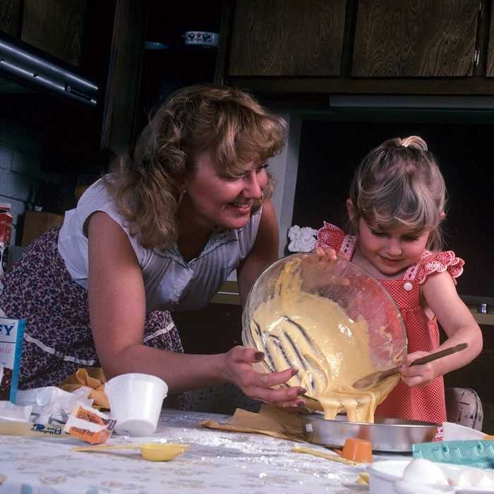 Mandatory Credit: Photo by Ralph Hampton/REX/Shutterstock (348408b) Model Released - Child cooking helped by her mother Child Cooking - 1981