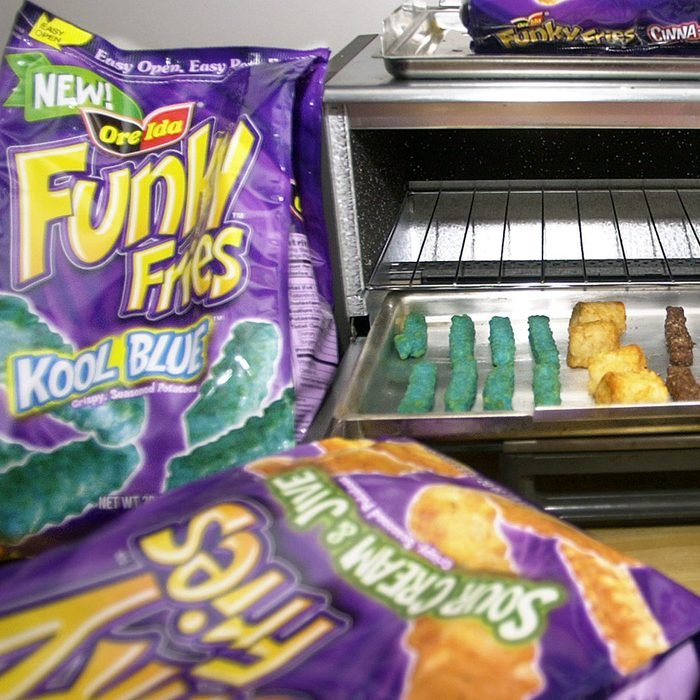 """Mandatory Credit: Photo by Keith Srakocic/AP/REX/Shutterstock (6456698a) BAKED FUNKY FRIES Packages of the new """"Funky Fries"""" that the H.J. Heinz Co. is marketing through their Ore-Ida brand surround a toaster oven with the """"Kool Blue,"""" left, """"Crunchy Rings,"""" center, and """"Cocoa Crispers,"""" right, varieties prepared in Pittsburgh, . Beginning in May, H.J. Heinz Co. will ship a new line of Ore-Ida frozen potato products called ''Funky Fries'' featuring five new shapes, colors and flavors, all intended to give kids even more say over their parents' grocery store lists FUNKY FRIES, PITTSBURGH, USA"""