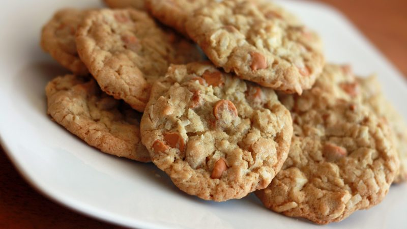 oatmeal butterscotch chip cookie recipe with cookies stacked on a white plate
