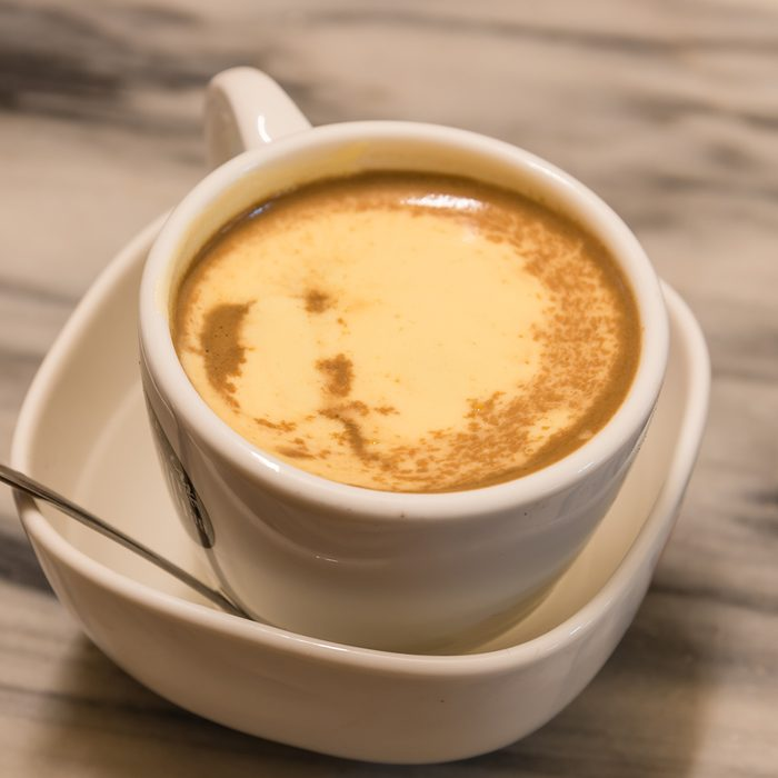 Top view a cup of Giang egg coffee in Hanoi on marble table.