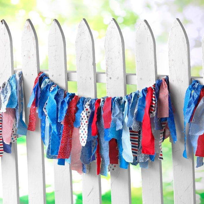 Handmade Fabric Garland on Fence