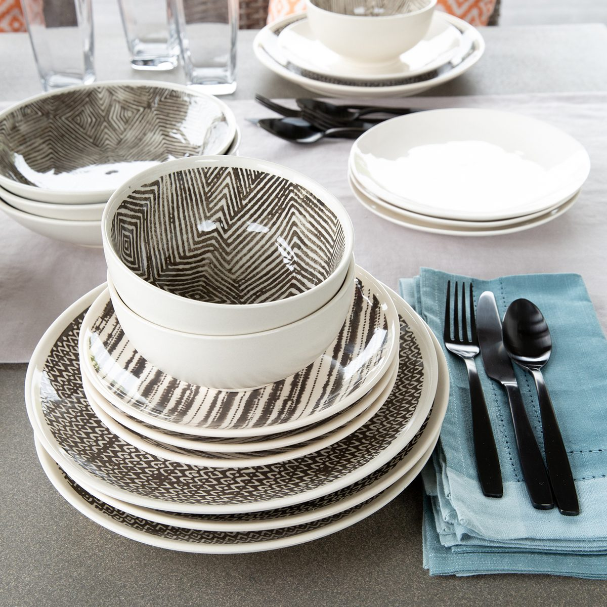Outdoor tabletop items including plates, bowls, flatware and napkins