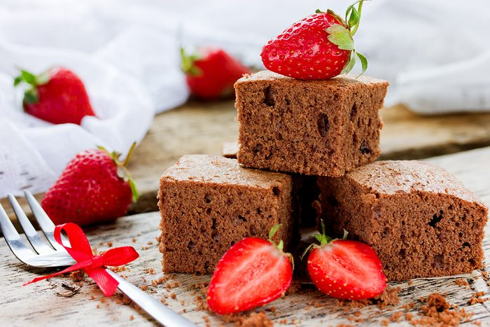 Chocolate cake with strawberry, traditional American cuisine, dark brownie with chocolate selective focus