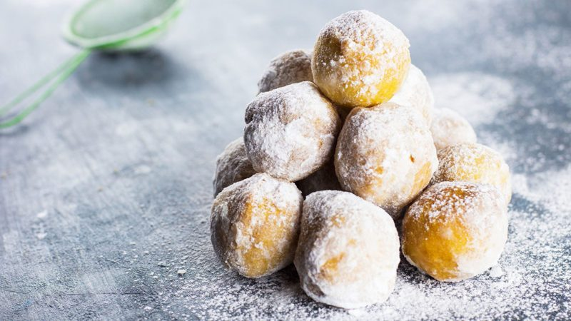 Sugared donut holes in a pile