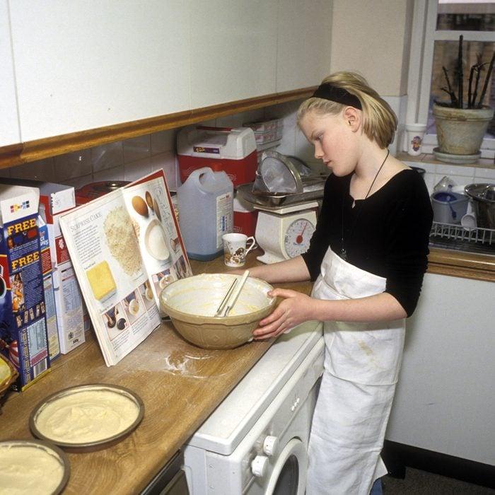 Girl baking cake in kitchen