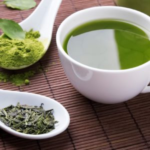 Green tea n the brown mat close-up