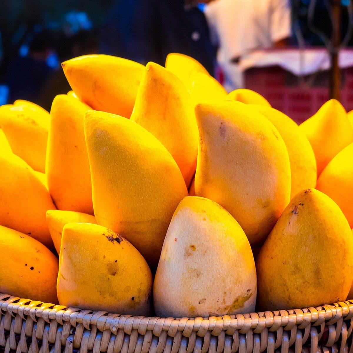 Yellow mango in basket.
