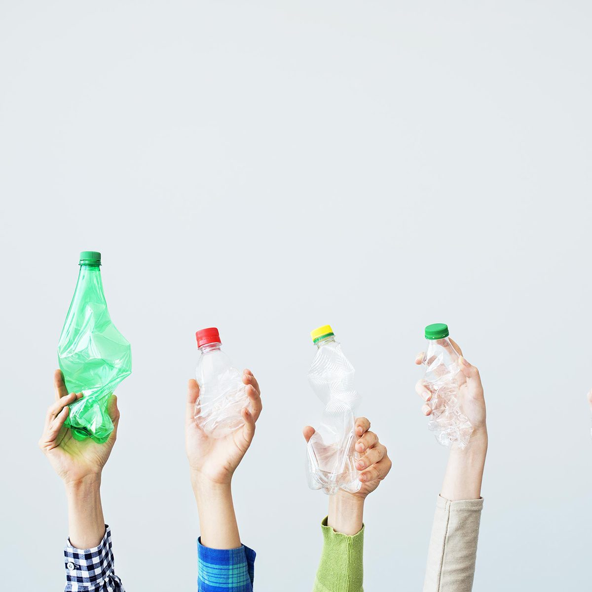 Hands holding up plastic bottles