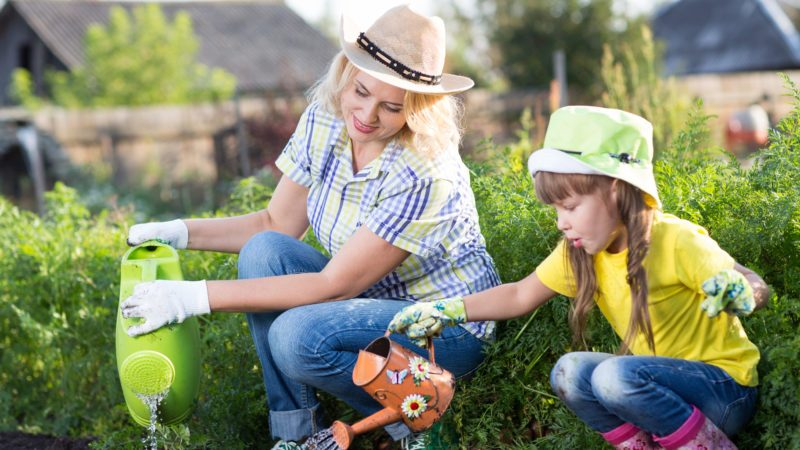 Family - mom and kid daughter are gardeners; Shutterstock ID 1054598993; Job (TFH, TOH, RD, BNB, CWM, CM): Taste of Home