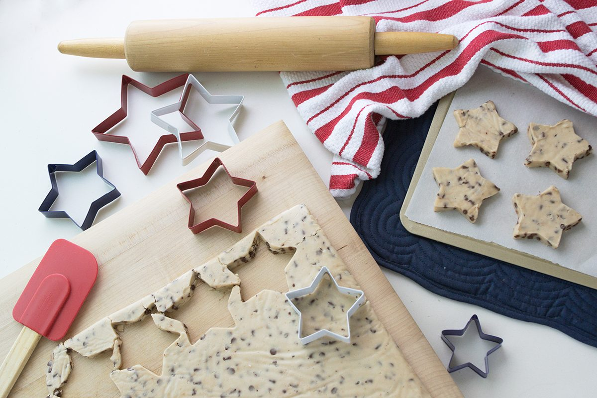 Flatlay photograph of patriotic baking. Star shaped cookie cutouts with red white and blue ; Shutterstock ID 1057855229; Job (TFH, TOH, RD, BNB, CWM, CM): Taste of Home