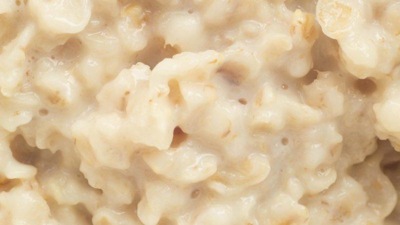 Boiled oat porridge, macro photography