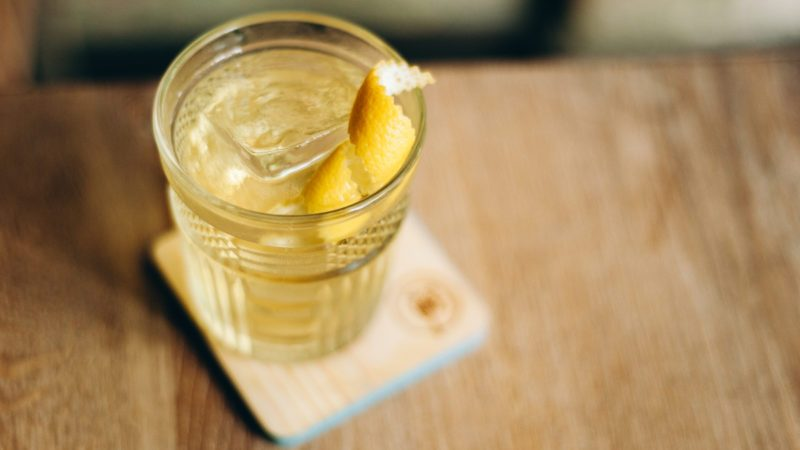 white negroni on a wooden table