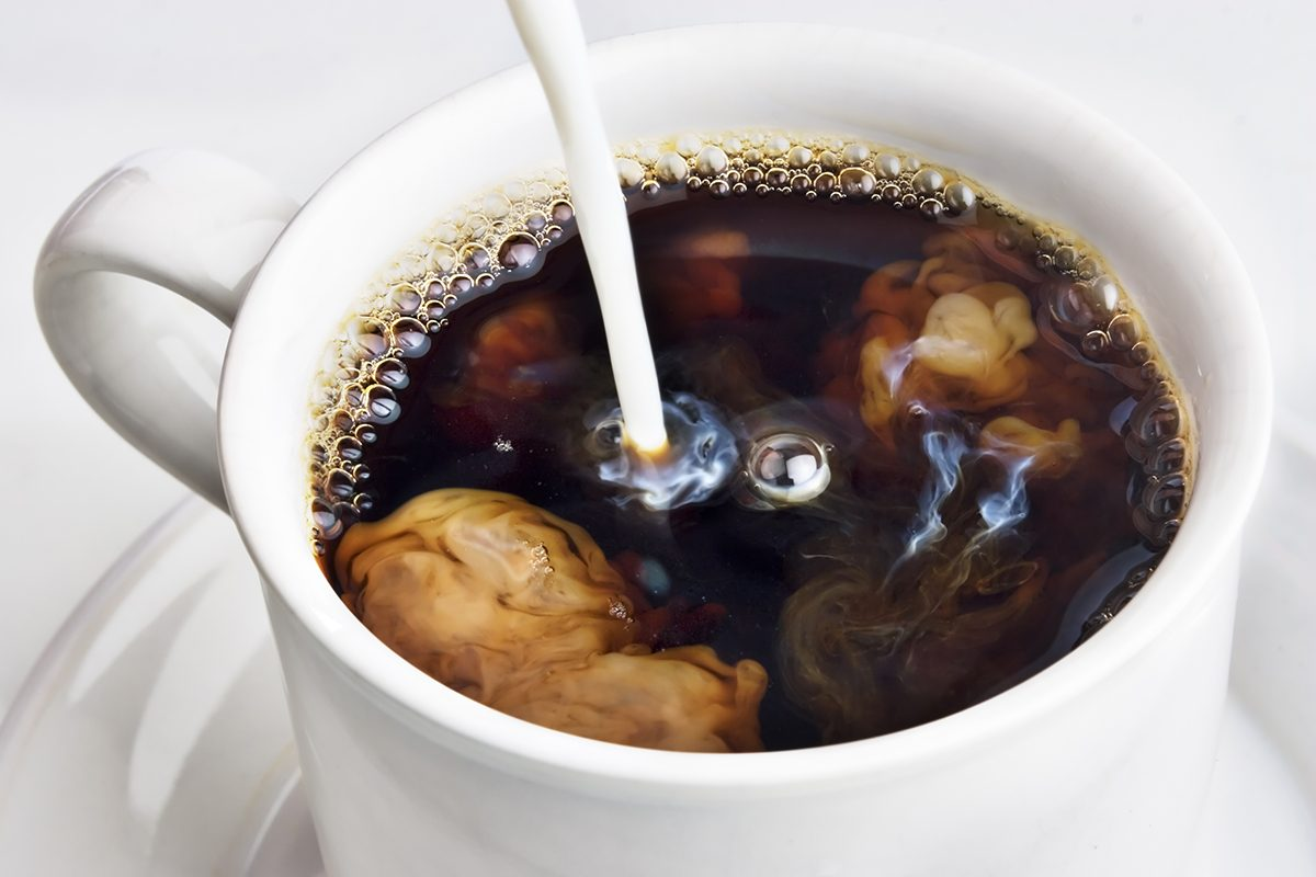 Pouring cream into a cup of coffee; Shutterstock ID 23391787; Job (TFH, TOH, RD, BNB, CWM, CM): Taste of Home