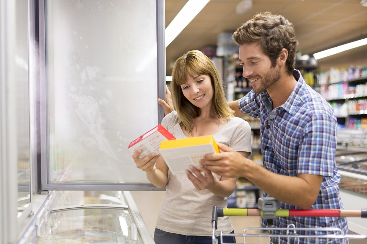 Young couple chooses frozen products in supermarket; Shutterstock ID 326438696; Job (TFH, TOH, RD, BNB, CWM, CM): Taste of Home